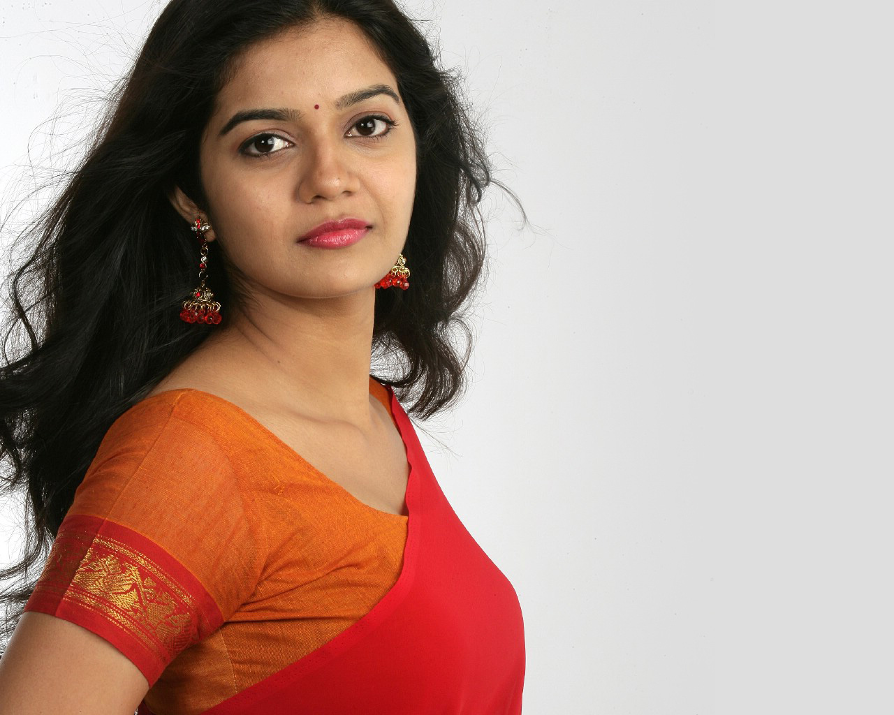 Colors Swathi in Red Saree