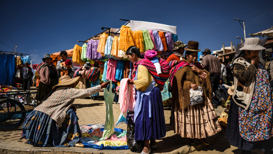 Busy Market with Dress Goods in Bolivia 109.21 Kb