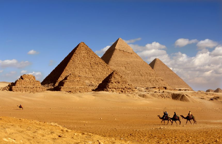 Camel Riders and Pyramids in Egypt