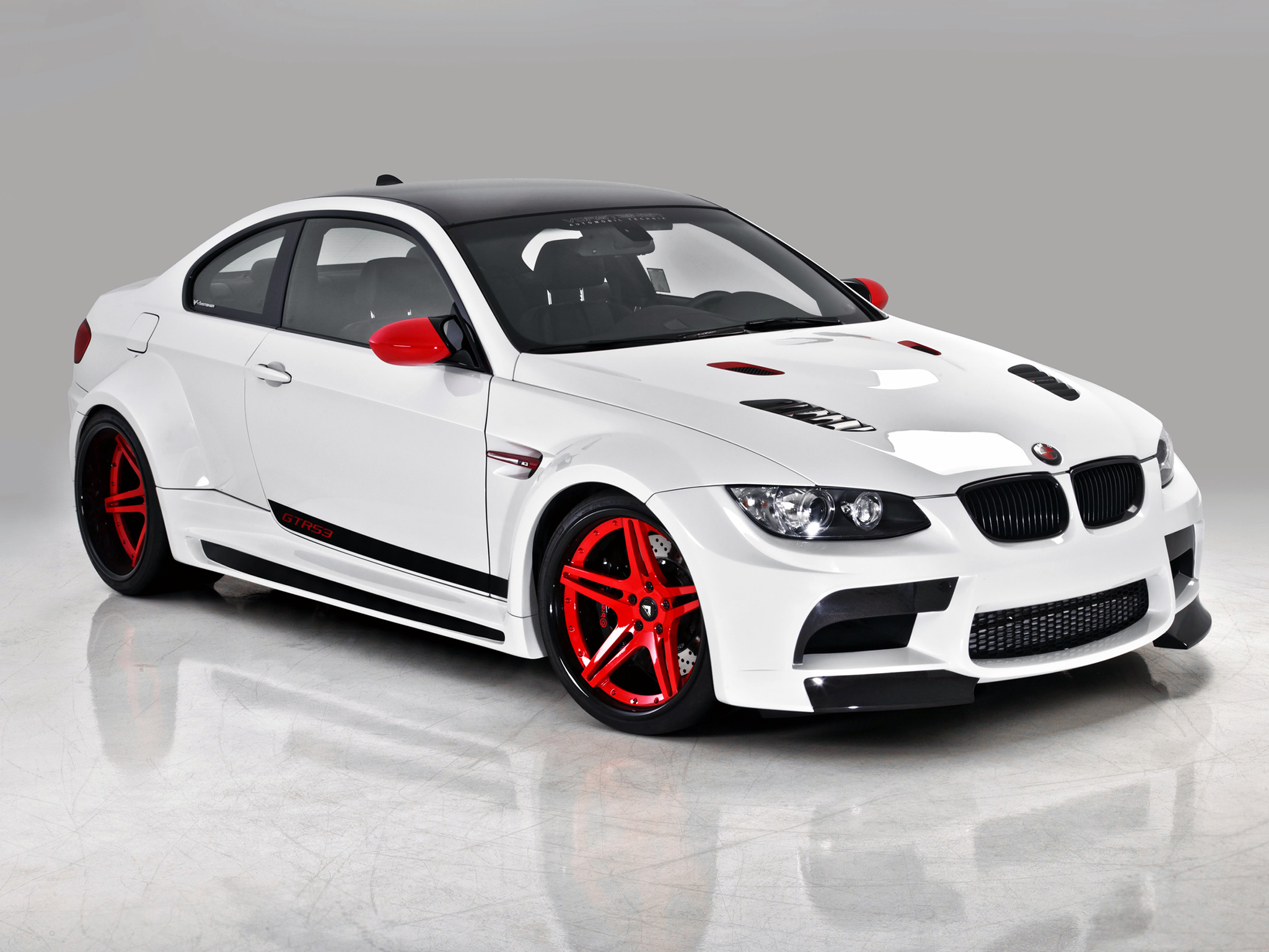 Sport White BMW with Red Wheels