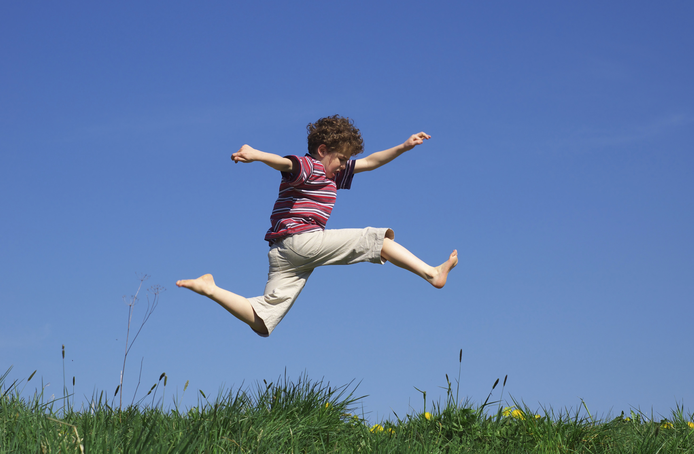 Jump of a Child on a Lawn