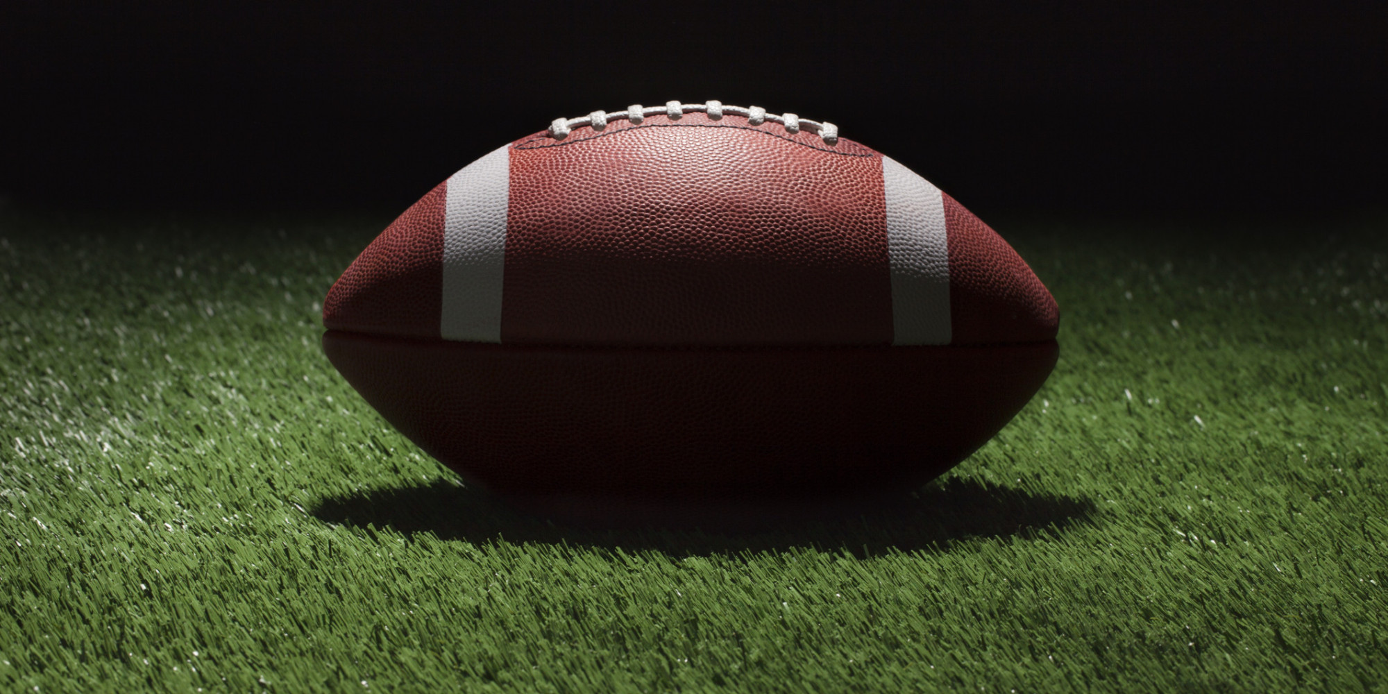 Football Ball in a Spotlight