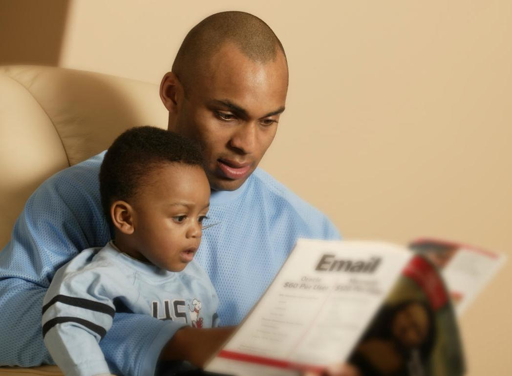 Father Reading a Book to his Child 770.41 Kb