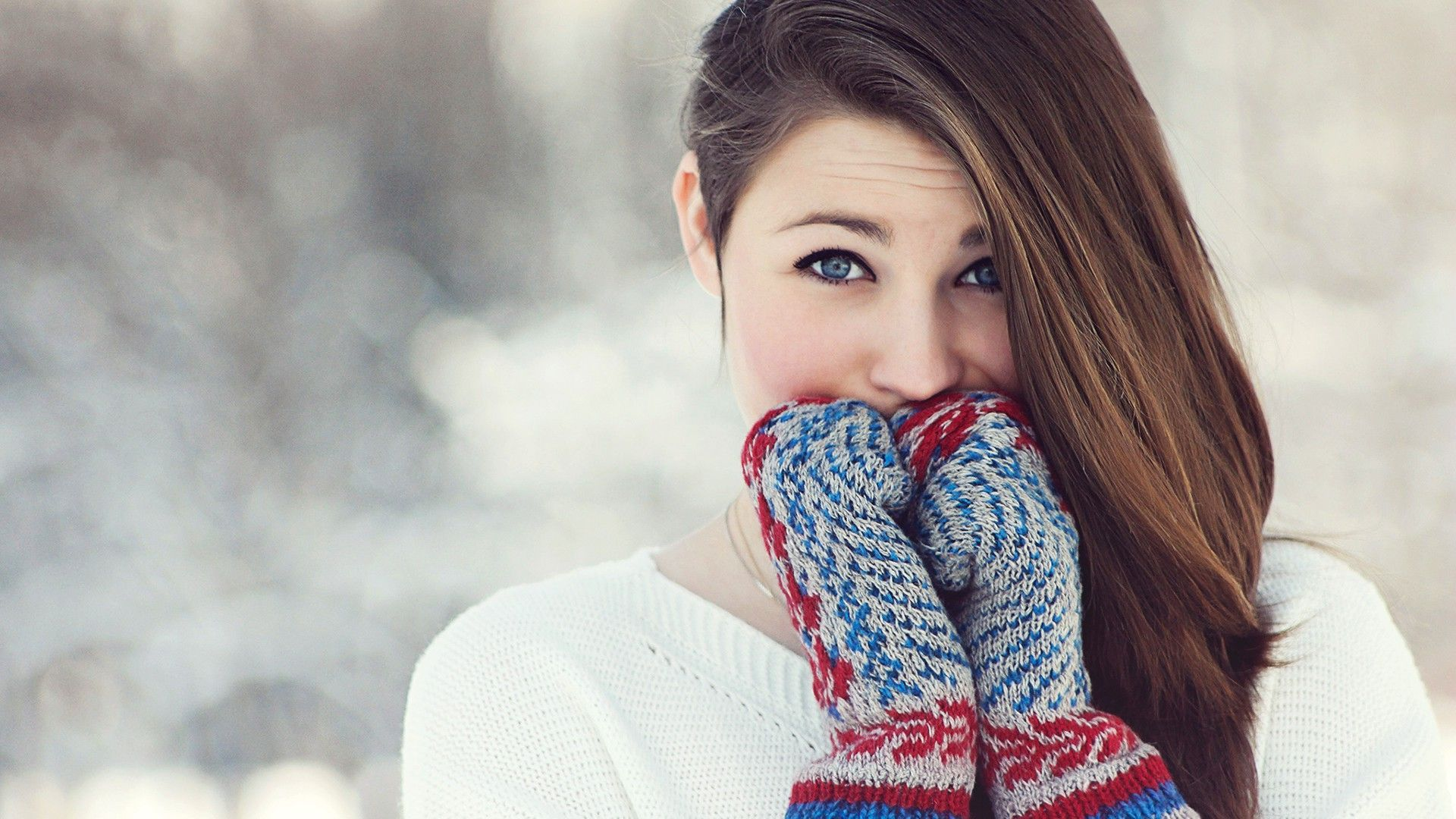 Girl Wearing Mittens in Winter