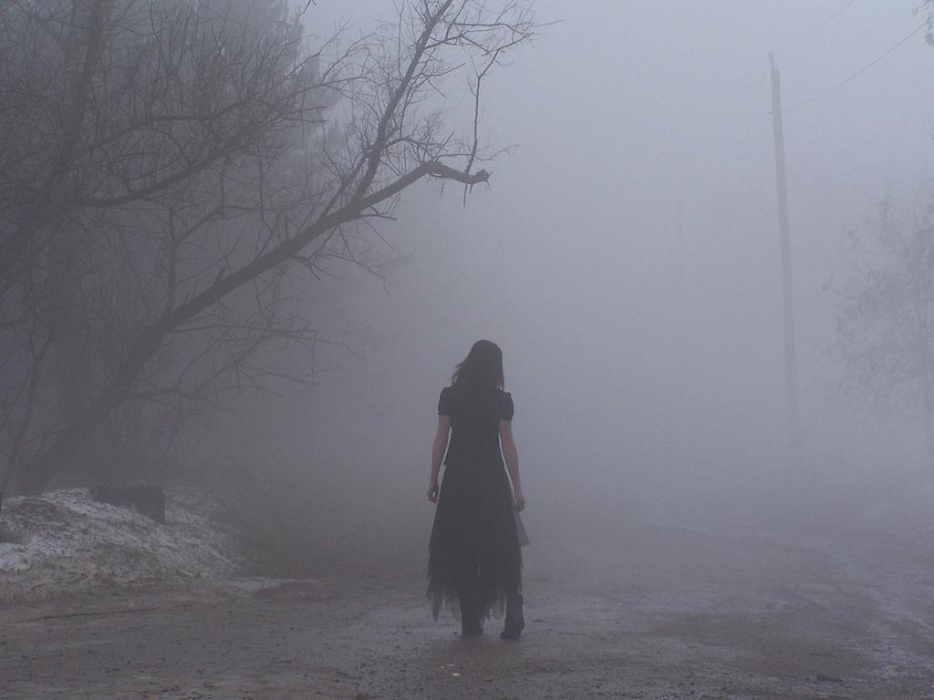 Lady in Black Walking in the Fog