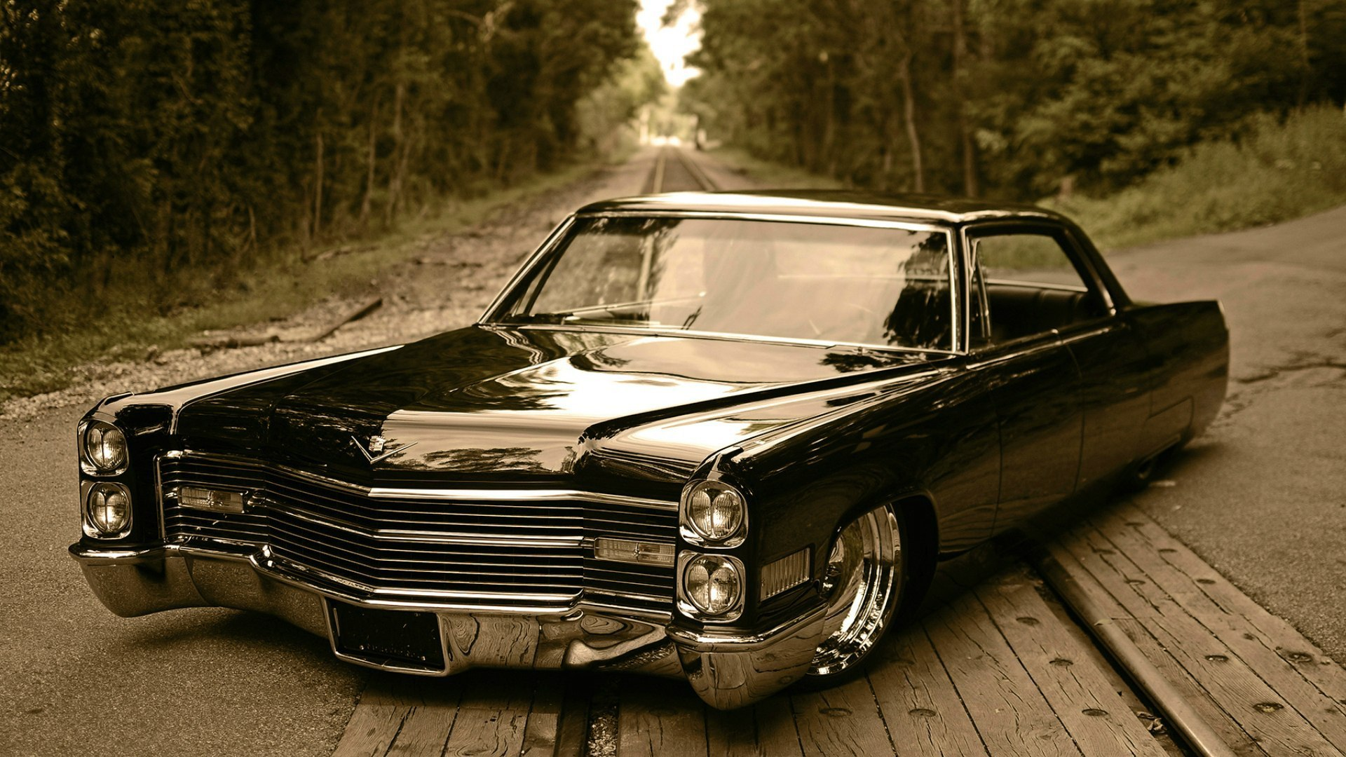Black Cadillac on a Railway in the Woods 128.4 Kb